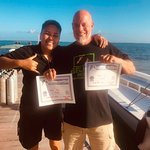 Me with Megan from the Shop, showing my two Specialty Dive certificates!