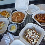 Left-Hot Head; middle: Spam Head on Cheese Bagel; Cinnamon Roll with Frosting cup; Front: Mac nu