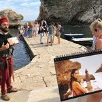 Use of a photo book & sanitized audio devices during our Dubrovnik Game of Thrones walking tour.