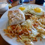 Chicken fried steak and eggs, country gravy on the side.