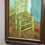 Van Gogh's chair in his room in Arle in southern France although the persctive on the tiles make