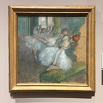 One of Degas' ballet dancers painting. He worked a lot from black and white photographs which a