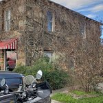 Exterior is part of a cluster of old buildings, lodging, office, gas station. They were the fore