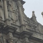 Facade detail - with asian dragon and death symbol side by side.