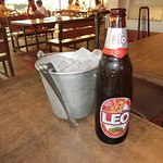 Beer served thai style with an ice bucket.