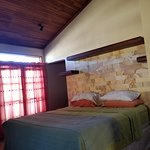 Comfy queen sized bed. High ceilings and beautiful petrified wood décor for headboard.