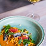 Tagliolini with baked tomatoes - citrus sauce, with segments of citrues, sardines, basil and coriander