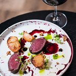 Saddle of venison with baked beetroot, balsamic gel and parsley oil