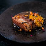 Baked pork belly with pumpkin purée, gingerbread and masala sauce
