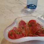 Big eye tuna crudo with olive oil,  sea salt,  and chives - one of a choice of daily crudo selections