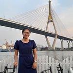 Bhumibol Bridge that behine me is very attractive.