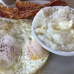 Delicious grits with eggs and bacon