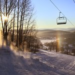 100% snowmaking with 13 trails, 1 quad lift, 1 handle tow and 1 T-bar.