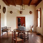 The entrance room decorated with antique tortoise shell, original wooden floors and Karoo style shutters