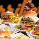 HAMBURGERS FROM CLASSIC CHEESEBURGER TO OUR WARNING WING CHEESEBURGER. HERE AT LOS PARRILLEROS RESTAURANT