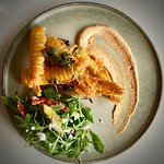 Firm and crunchy battered prawns with fresh garden salad and paprika aioli..