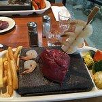 Steak and prawns stone grill