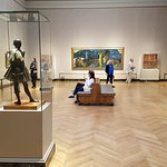 Edgar Degas' Little Dancer to the fore with Gauguin and others in this room.