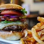 Logan Smash Burger - 7oz patty, greens, tomato, red onions, jalapenos, smoked cheddar, chipotle
