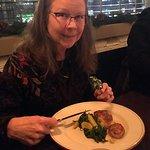 Cynthia enjoying their superb scallop starter.