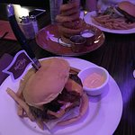 burger with onion ring tower