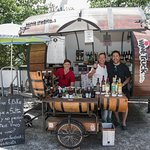 the lovely owner, son and chap who helped withe designing (and/or building?) the wine truck/bike