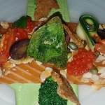 Beautifully presented fresh salmon antipasti with basil and fresh local almonds from the daily s