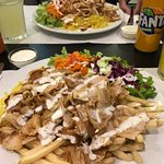 Massive plate with chicken kebab.