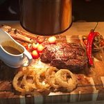 Tomahawk steak. Meat-lovers delight. All the trimmings and a choice of sauce.