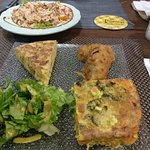 Couscous salad, tortilla, vegetables with coconut from the oven and fish fritters