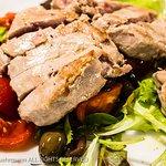 Tagliata di Tonno Rosso con olive capperi e pomodorini = Sliced tuna steak with mixed salad of o