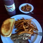 Lunch smoked brisket plate with sides of fries and baked beans