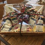 A Christmas hamper filled with sweet and savoury treats. Lovingly put together and delivered loc