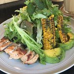 This is char grilled corn salad with pesto dressing, grilled chicken, avocado. Very fulfilling.