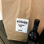 Shabbos Food delivery along with a bottle of wine