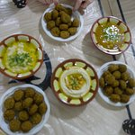 Clockwise from the top: falafel, ful medames, more falafel, hummus with green chili. more falafe