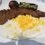 Barg Kabob served on a bed of fluffy basmati rice with grilled tomato and Anaheim pepper