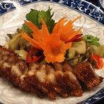 Thịt ba chỉ chiên nước mắm (Grilled pork with local herbs)