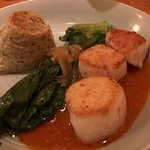 Sea scallops with tomato-truffle butter, savory rice custard.
