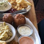 Fried shrimp coleslaw and hush puppies