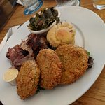 Pulled pork dish with collards, fried green tomatoes and one of the best cornmeal muffins I've e