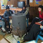Keeping warm by the stove with Ram and our incredible porters.