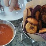 plantains grilled and blue corn chips pre dinner with spicy sauce