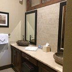 Master bath on main floor. 2 sinks, large 5 ft shower with glass doors. Vanity sinks made of natural stone.