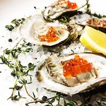 Oysters on the half shell with Champagne gelee & Trout roe.