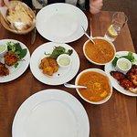 Peshwari Nan, Onion Baghi, Fish bits, Veg Curry, Coconut King Prawn Curry and Tandoori Chicken wings.