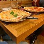Linda pizzaria e ótimos pratos. Pizza ótima novo conceito e ingredientes de primeira qualidade