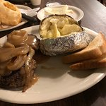 large hamburger steak with baked potato