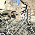 Biking on Appia Antica, stopped for a rest by medieval fortress built into pre-existing 2nd century burial tombs.