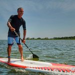 Our friend Robert cruising on the JP race model. We carry JP and Starboard Paddleboards new and for rental. These are higher end paddleboards with various models from longer displacement hulls for flatwater to shorter surf style SUPs.